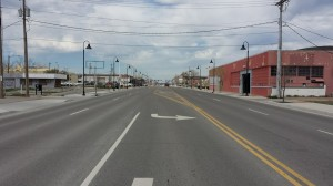 horrible overly-wide arterial Street (Stroad) with decorative light poles.  Photo by Chuck Marohn